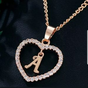 New gold tone letter A necklace